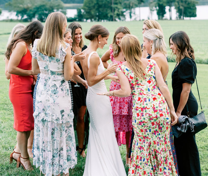 group of young ladies standing around at a wedding rehearsal