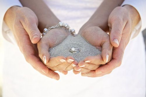 couples with sand in their hands holding wedding rings the celebrant angel aberdeen blogs