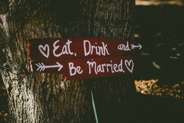 signs point where to go in an out door wedding making a small wedding fun