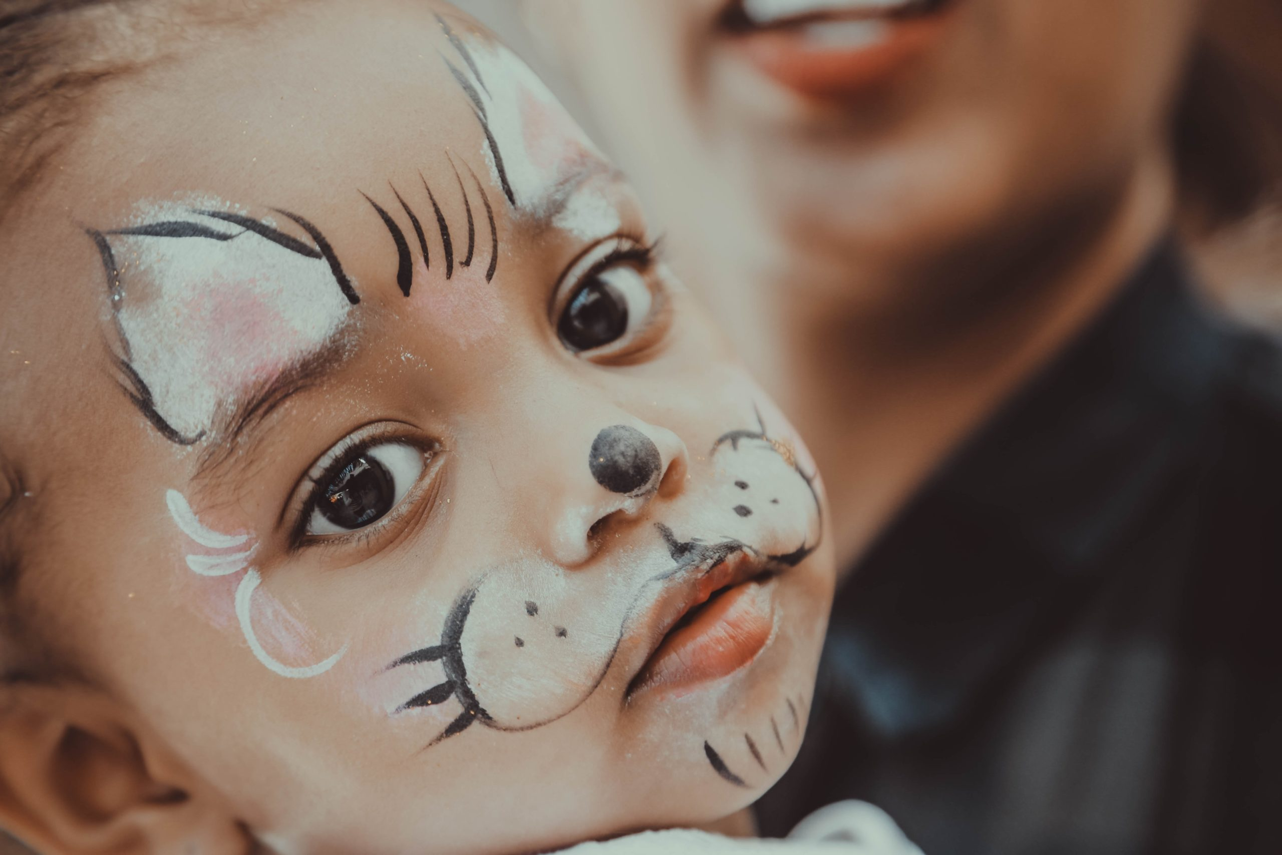 child with face painted like rabbit family and naming ceremonies in aberdeen