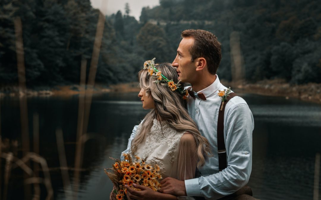 bride and groom sitting on a loch what is a couples ceremony the celebrant angel