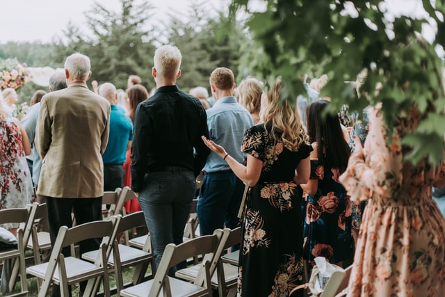 group of people at a wedding top tips on how to downsize your guest list