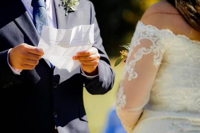 couple at a wedding reading their vows to each other