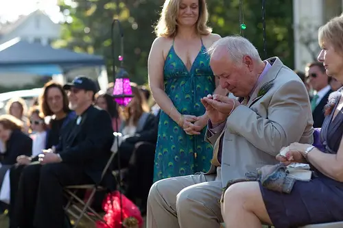 man blessing the wedding rings at a wedding ceremony