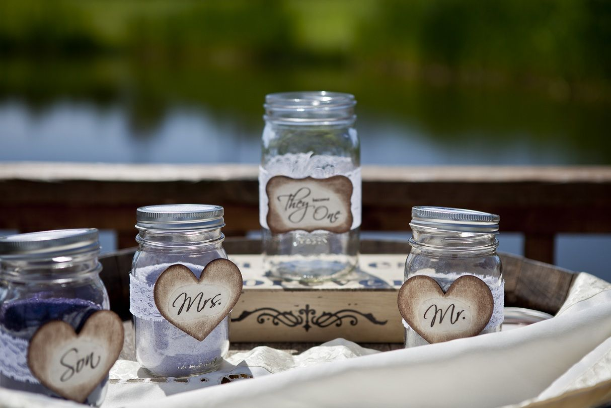 photo of small bottles used for a sand ceremony in a wedding