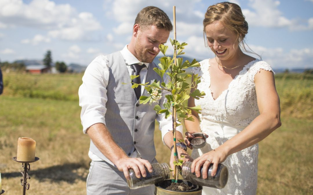 photo of a couple planting a tree during using the symbolic ritual with the celebrant angel