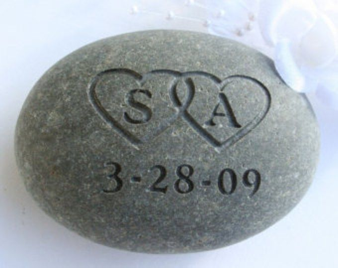 photo of a stone engraved for a wedding ceremony, the oathing stone ceremony