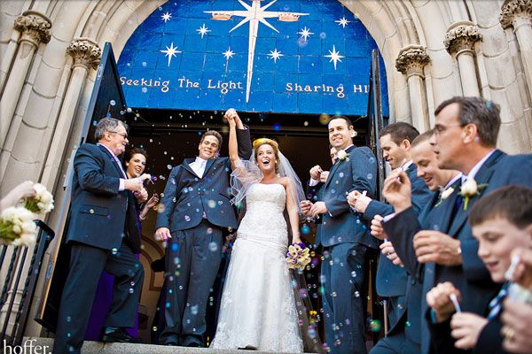 wedding couple exiting a church tops tips on a wedding receiving line