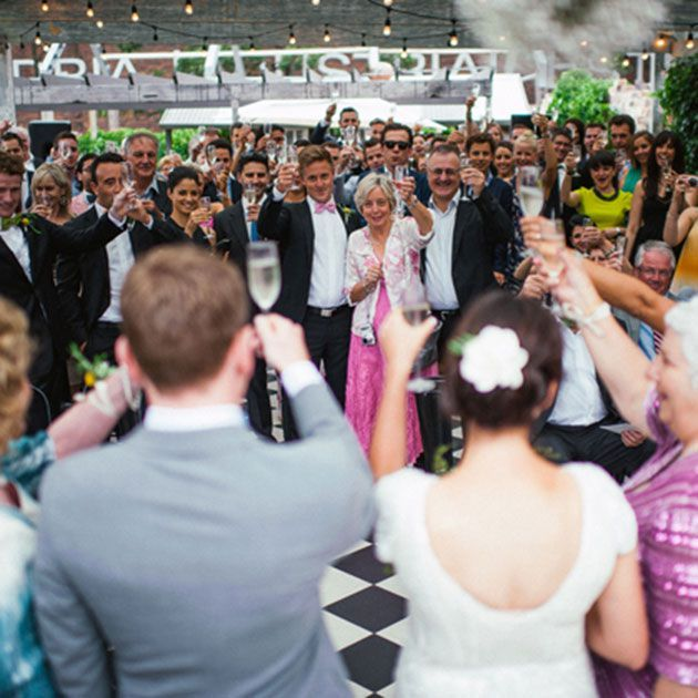 croweds toasting a bride and groom top tips for a wedding receiving line