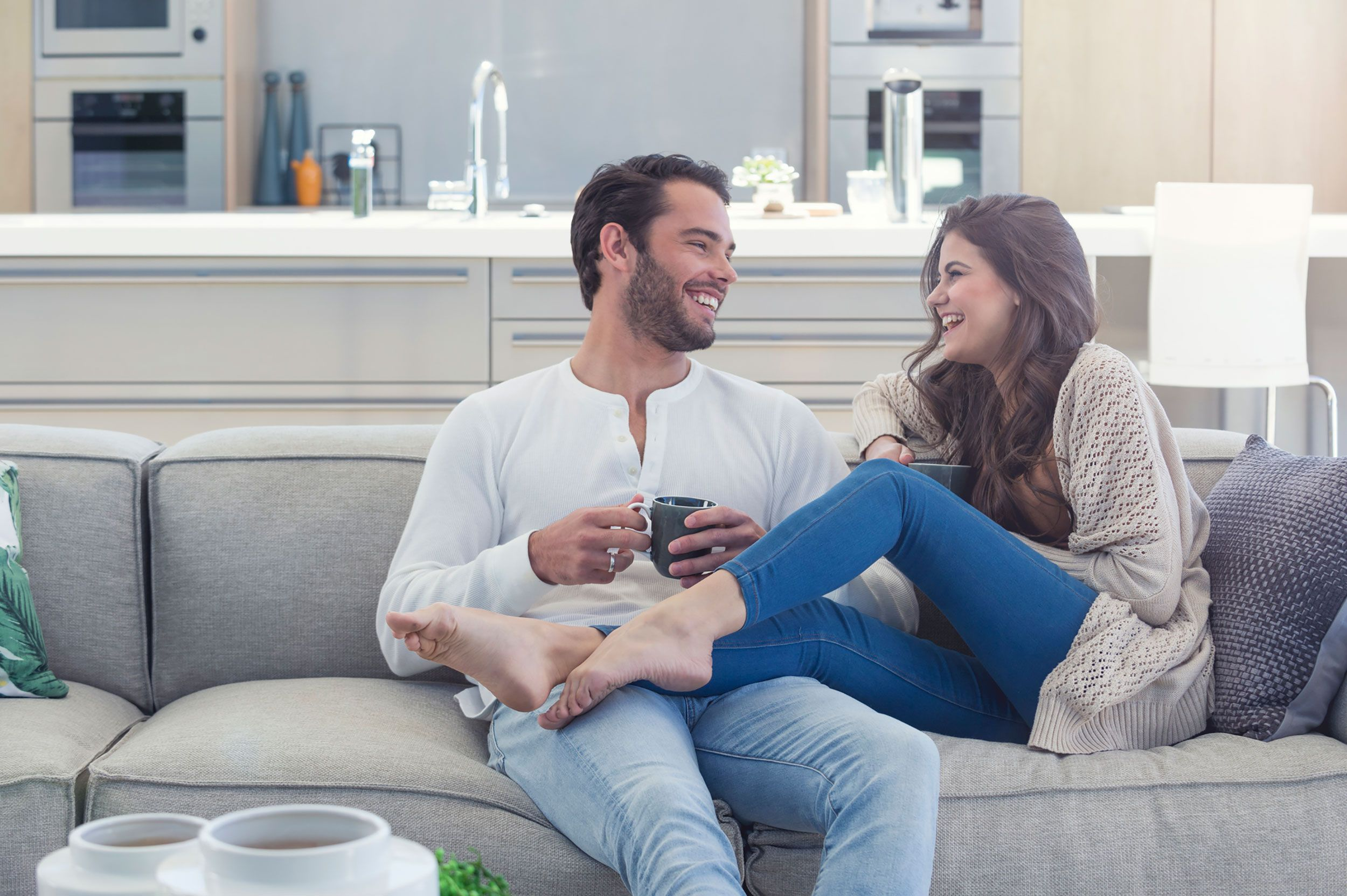 couple having coffee laughing how to reduce stress while wedding planning