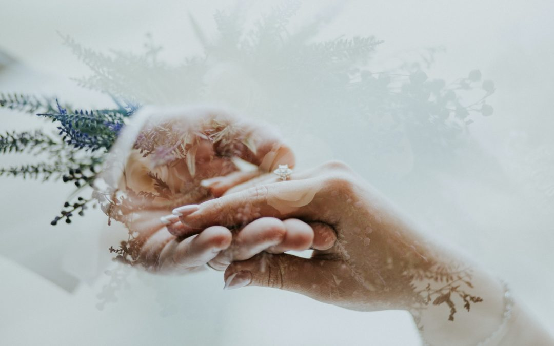 bridal couple holding hands,whats including in the celebrant angel services
