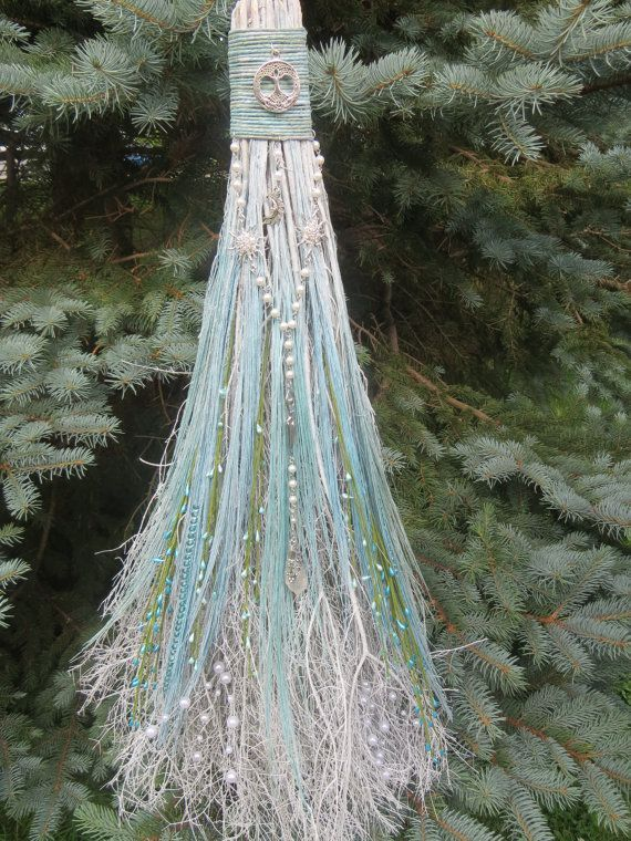a photo of a broom decorated fora jumping the broom ritual in a wedding
