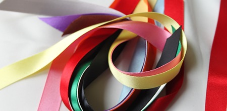 photo of brightly coloured handfasting ribbons