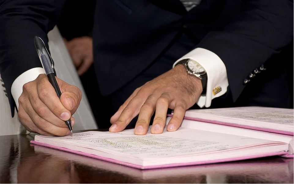 man signing a register how to get legally married in aberdeen with the celebrant angel