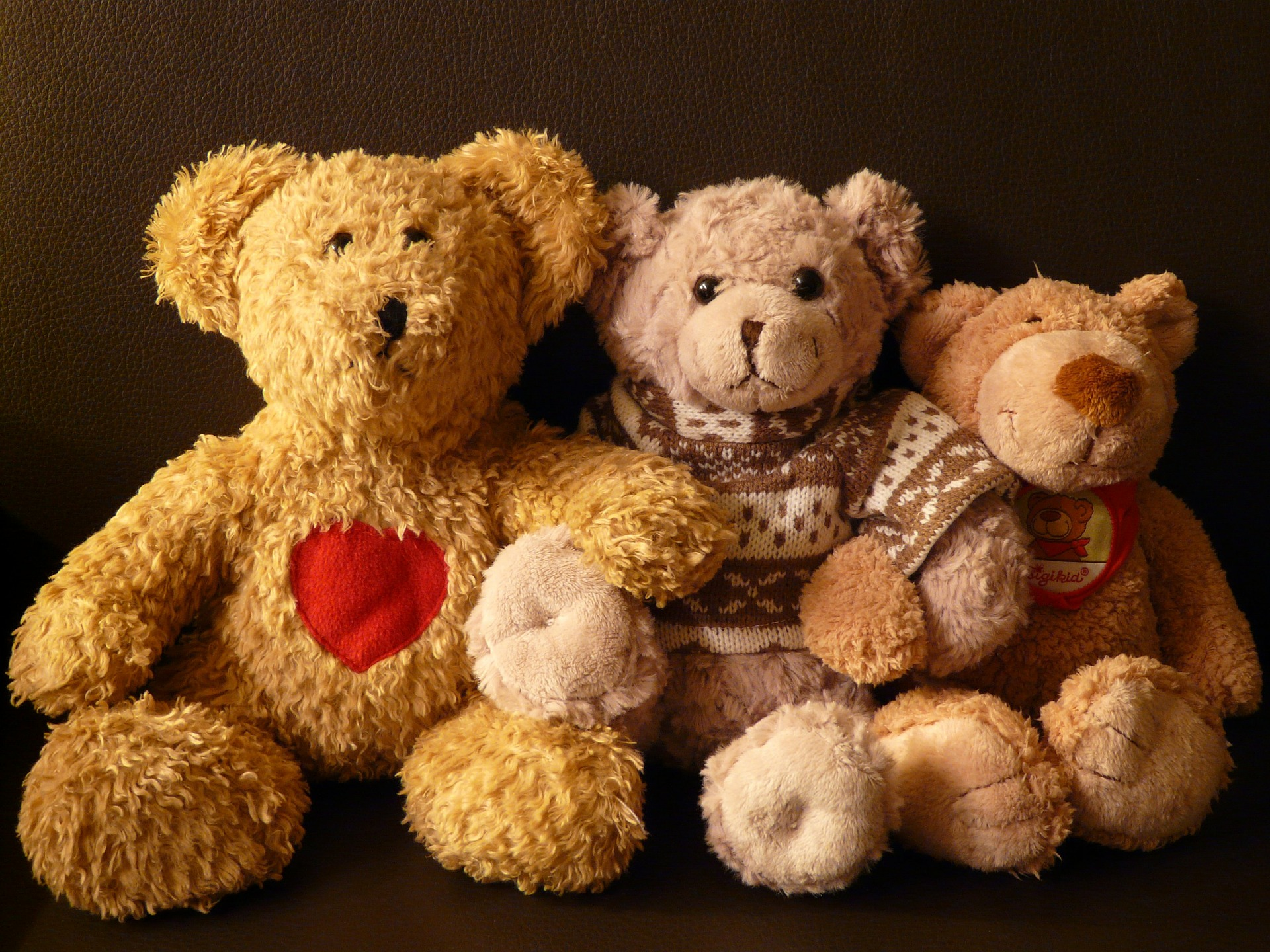3 teddy bears sitting in a row family and naming ceremonies with the celebrant angel