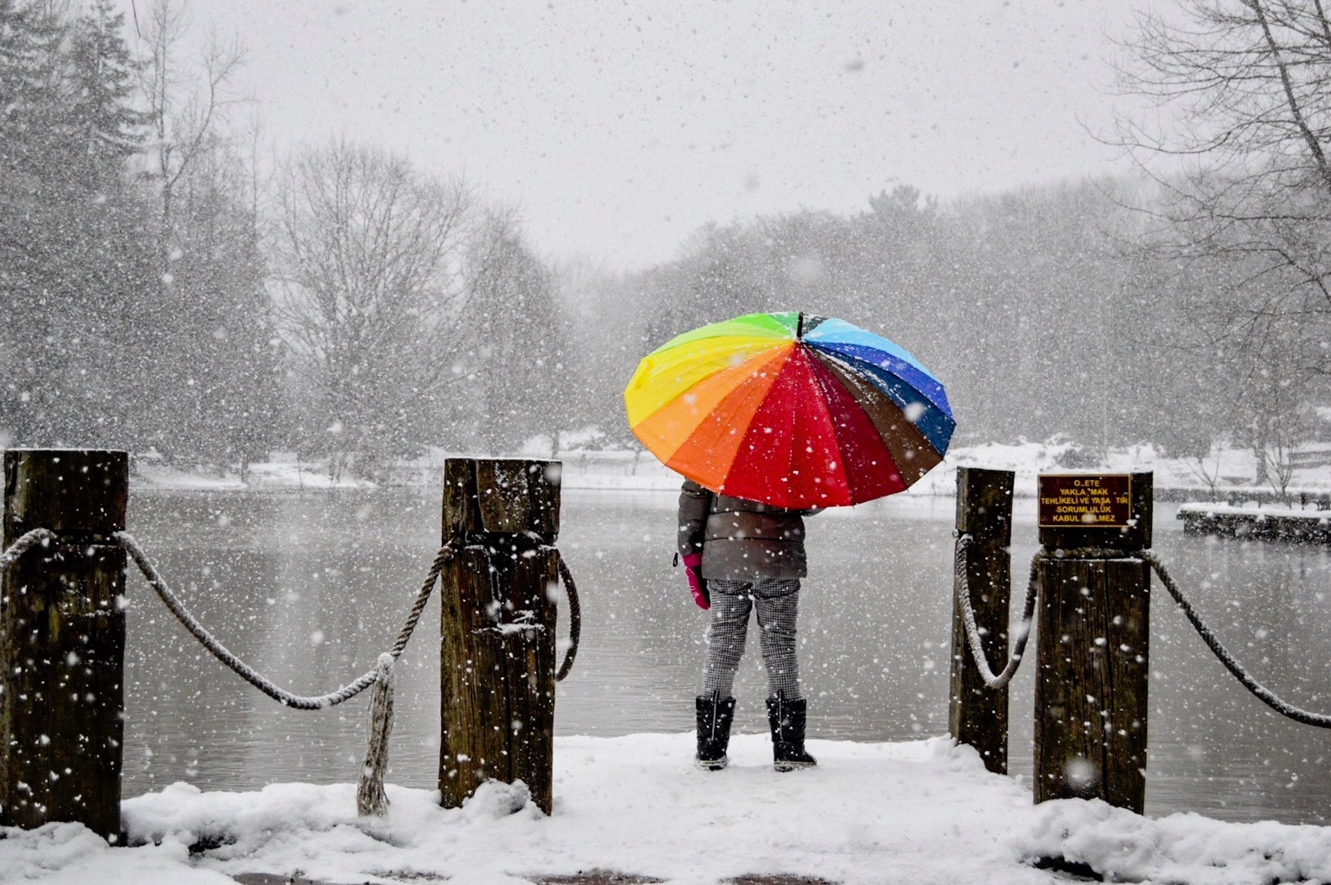 person standing in the snow with a colourful umbrella how to calm wedding day nerves celebrant angel Aberdeen