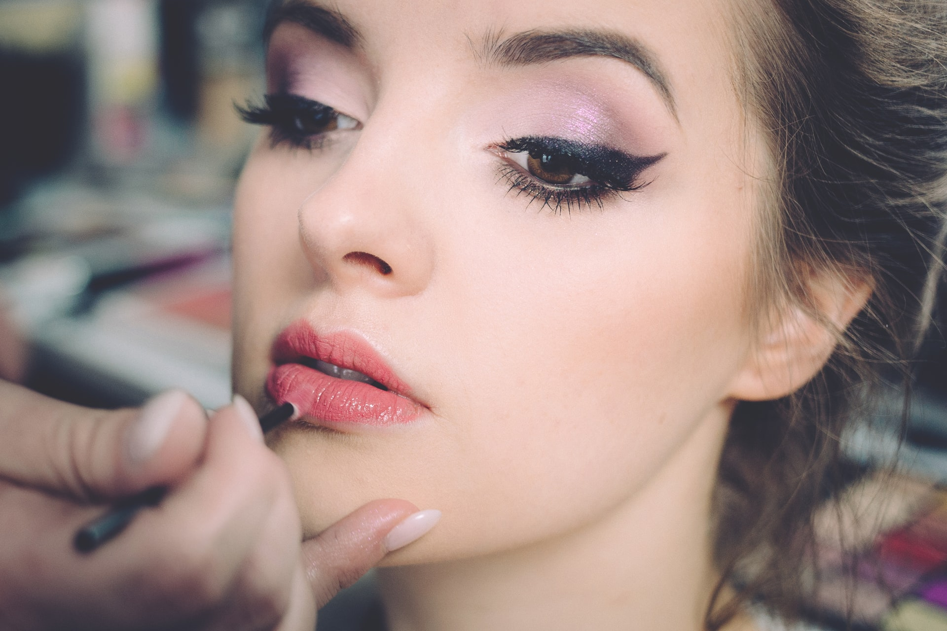 photo of lipstick being applied by make up artist how to calm  wedding day nerves with the celebrant angel