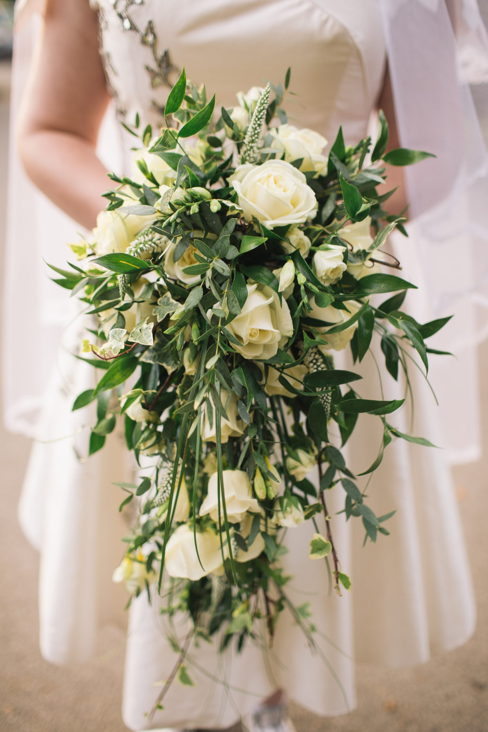 picture of a cascade type of wedding bouquet with the celebrant angel aberdeen