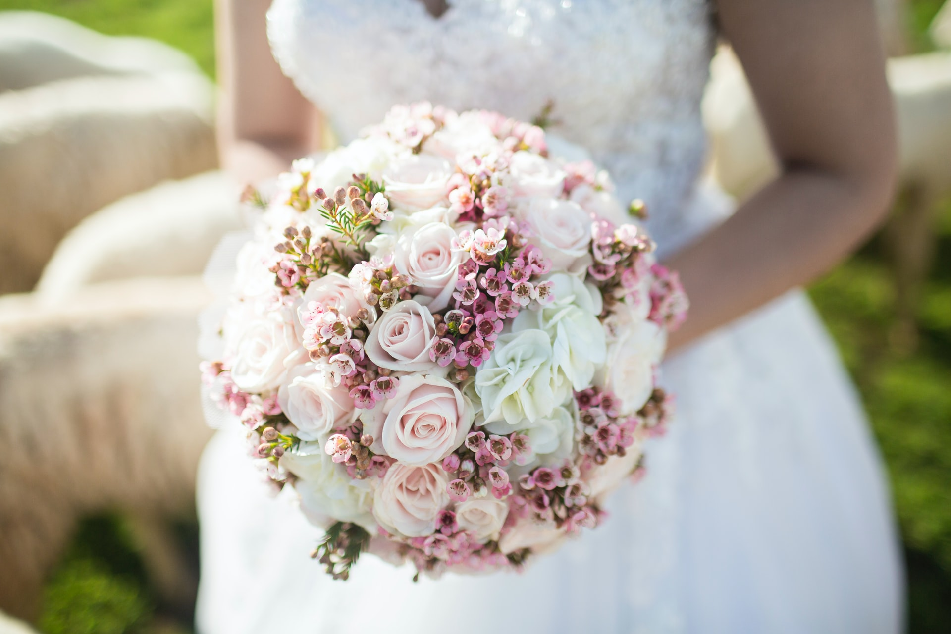 photo of a round wedding bouquet about types of wedding bouquet with the celebrant angel aberdeen
