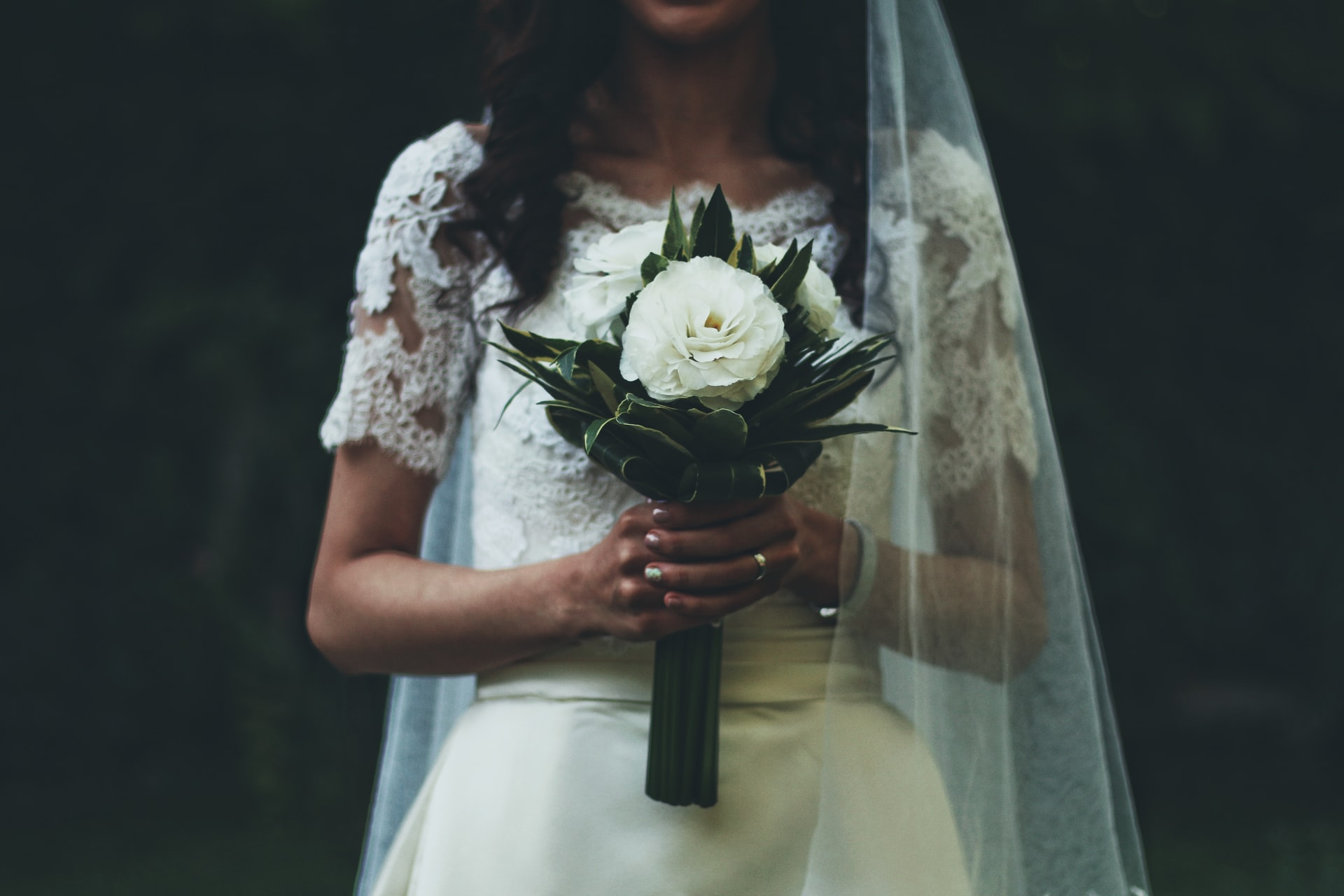 a single stem type of wedding bouquet with the celebrant angel